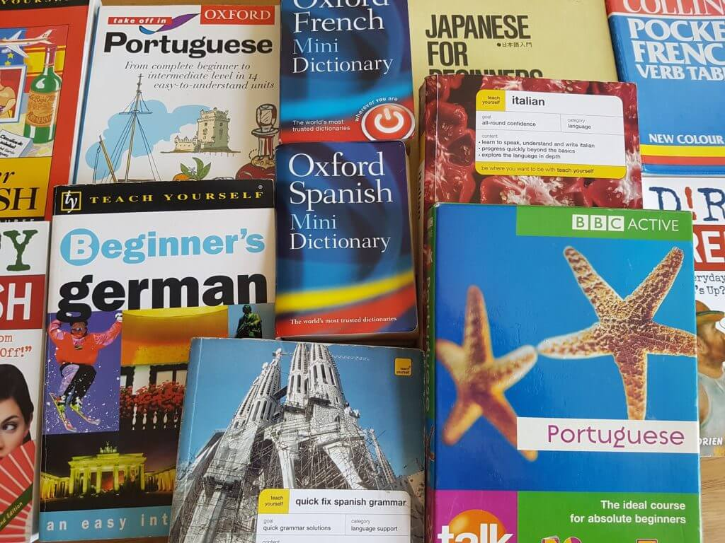 A pile of dictionaries and translation books - inferior to professional translation services