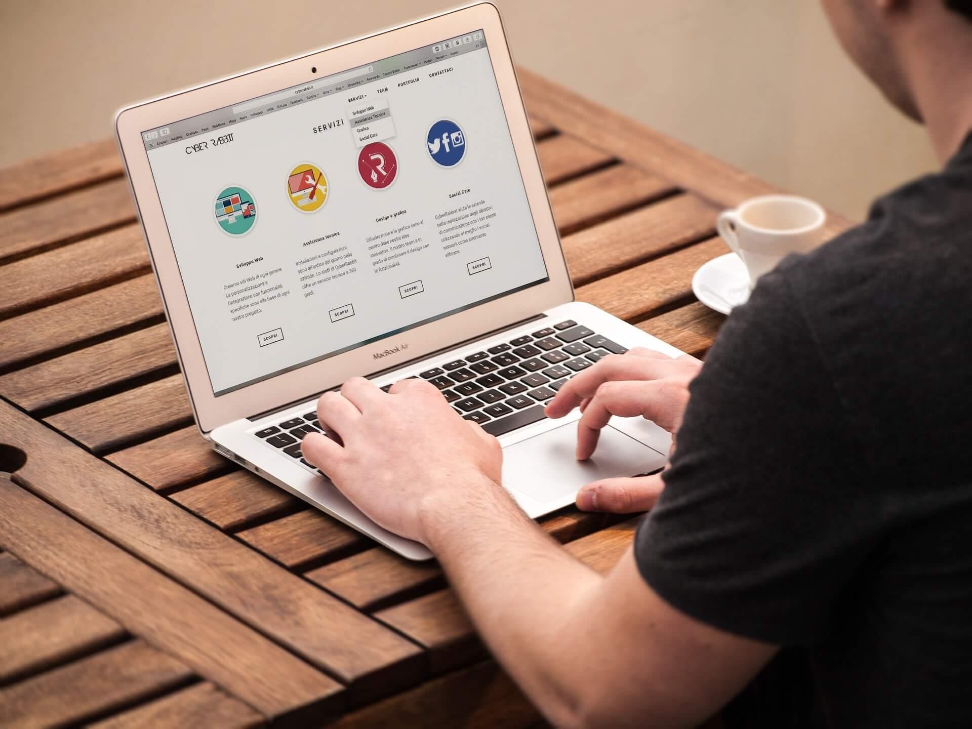 A man at a computer looking at translation services